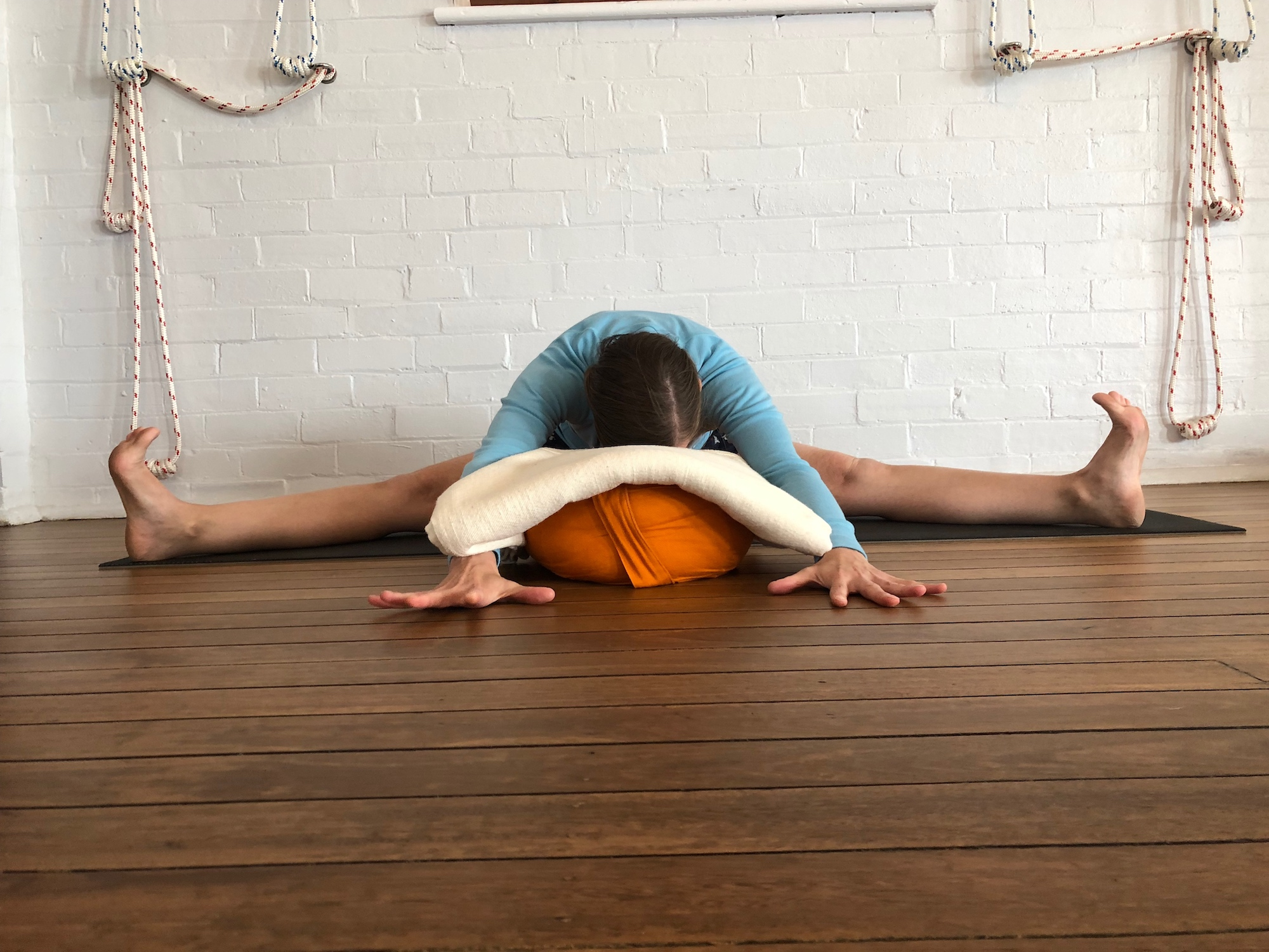 upavishta konasana supported yoga pose at Hamilton Yoga Iyengar Yoga school in Newcastle New South Wales