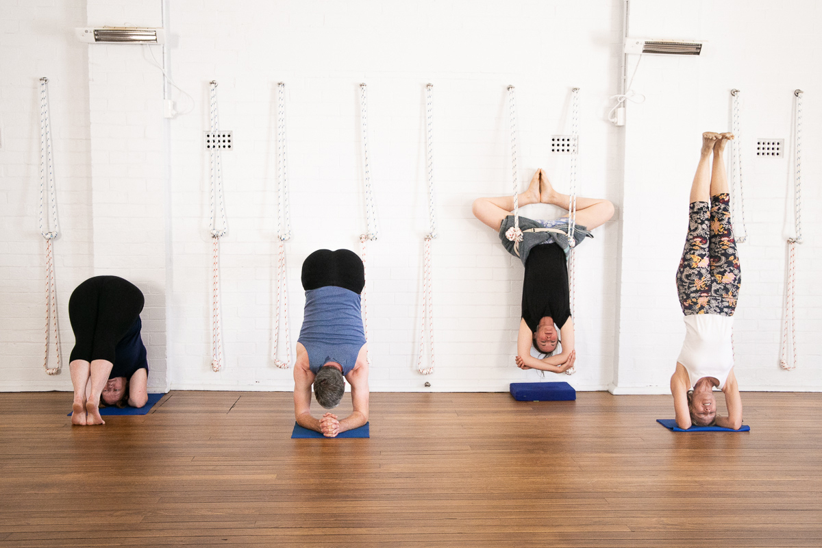 Teachers at Hamilton Yoga in Newcastle New South Wales in a few of the many headstand variations