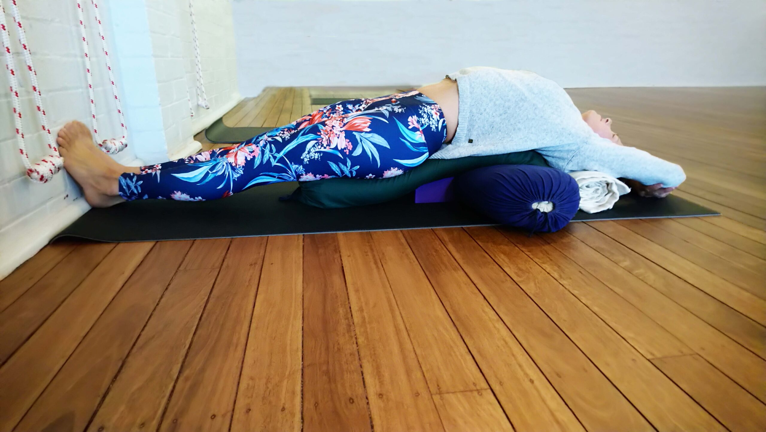 A student in a restorative yoga pose at Hamilton Yoga in Newcastle New South Wales