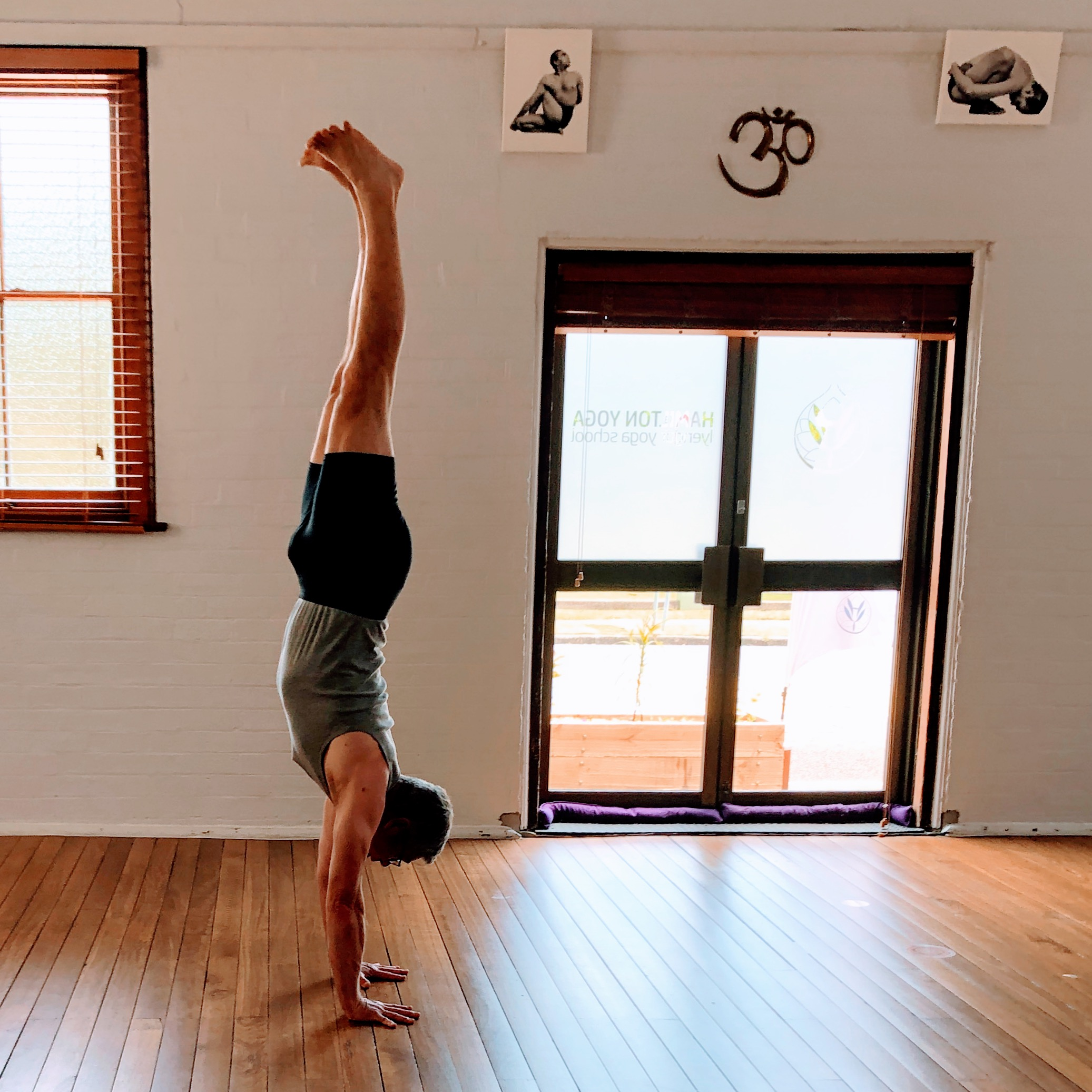 David Morley in adho much vrksasana (handstand) at Hamilton Yoga in Newcastle New South Wales